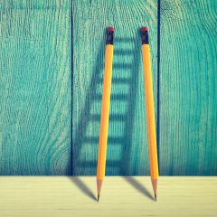 Good Copywriting Concept - Pencils Against Wooden Wall Forming Ladder